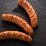 sausages-black-marble_66899-510