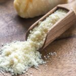 parmesan-cheese-wooden-board_165536-3791